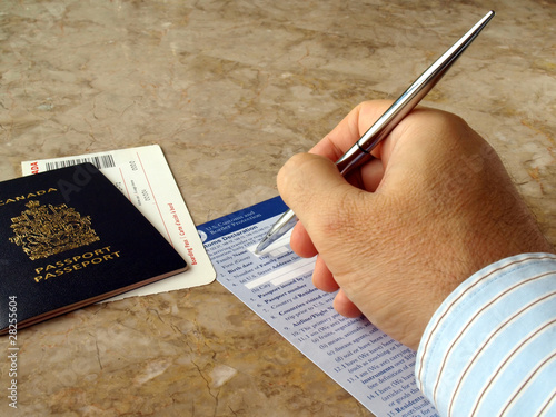 Man filling out U.S. customs and border form