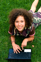teenager girl using laptop outdoors
