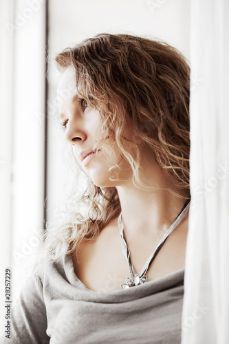 Beautiful woman against a window.
