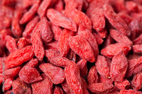 Pile of red dried goji berries, close up