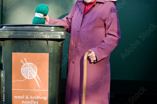 A senior woman recycling a ball of wool