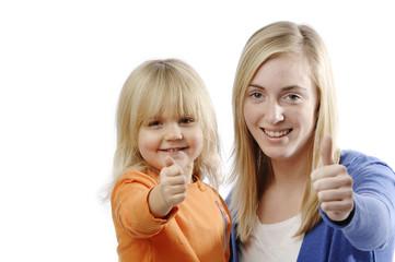 Teenage girl and toddler flash thumbs up