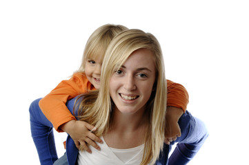 Teenage girl piggybacks a toddler