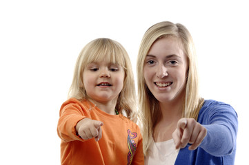 Teenage girl and toddler point thier finger.