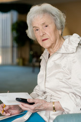 elderly woman on blackberry