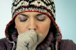 Young Woman in woolen cap coughing