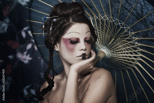 portrait of a beautiful white girl in geisha style