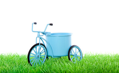 Dutch blue transport  bycicle on a green lawn isolated over whit