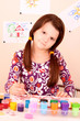 young and cute little girl painting a picture