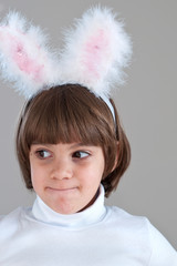 Pretty smiling  little girl in bunny ears