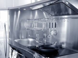 Kitchen silver sink and vitroceramic stove hob