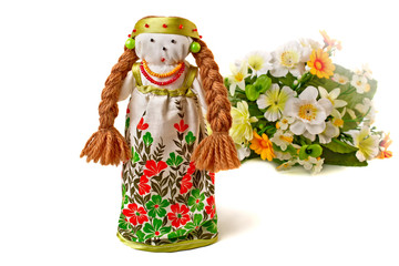 Russian traditional doll in dress and a bouquet of flowers.
