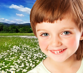 little girl and meadow with daisies