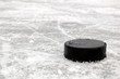 black hockey puck on ice rink - 28287084
