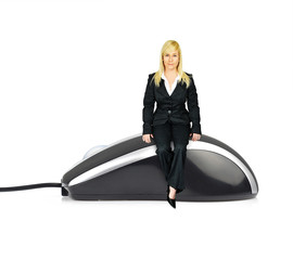 Business woman on computer mouse