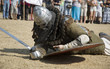 Medieval warrior defeated lying inside the fortress festival