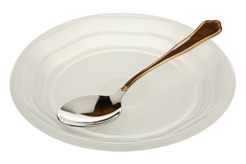 Metal spoon in a plastic plate