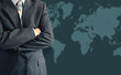 Businessman in front of world map