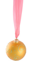 Hanging golden Christmas ball with a pink ribbon