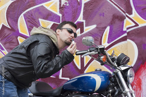 Motorcycle Man Making Up with Lipstick