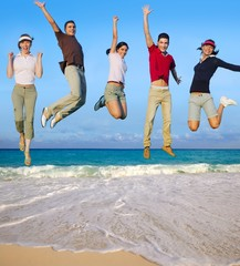 Jumping young people happy group tropical beach