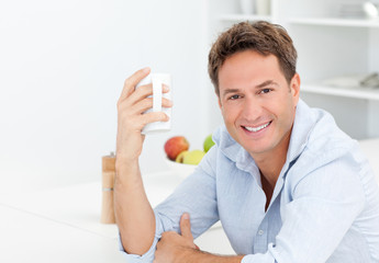 Happy man enjoying his coffee during a break