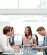 Glad businesswoman talking to her team