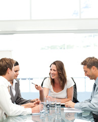 Cheerful manager talking to her team during a meeting