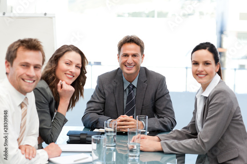 Portrait of a positive team sitting at a table - 28309848