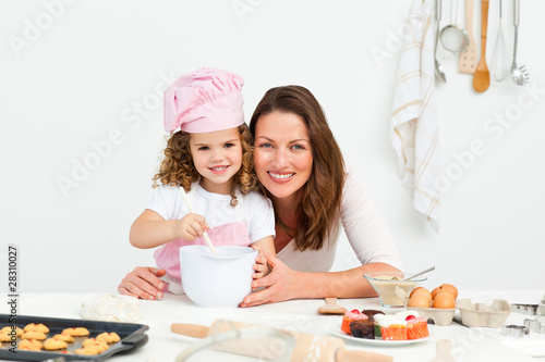 Portrait of an adorable mother and daughter preparing a daugh to