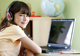 Girl using computer at home