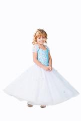 cute little girl wearing fluffy gown