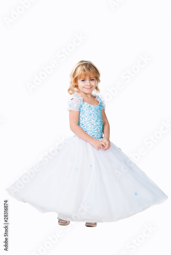 cute little girl wearing fluffy gown