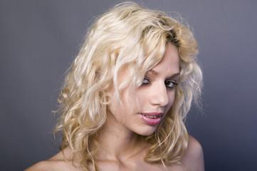 Studio portrait of beautiful blonde woman