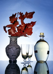 Maple branch, vase and wine bottle with goblets