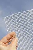 Detail of glass-fiber mesh – reinforcing material for insulation poster