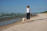 Woman and dog on the beach - Pinery, Lake Huron, Ontario