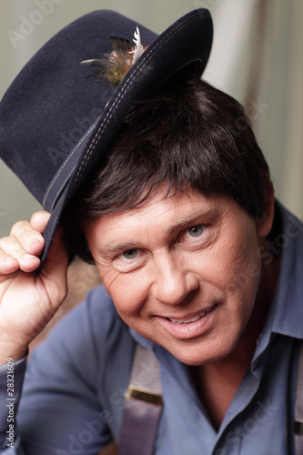 Man smiling and tipping his hat