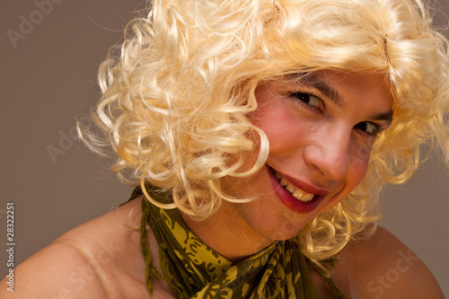 Funny face of a man dressed as a woman