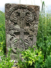 Old Cross stone in grass