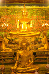 Golden buddha statue in church at temple