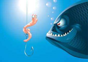 A scared worm before a big predator fish