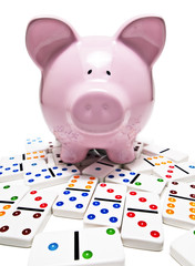 piggy bank and dominos