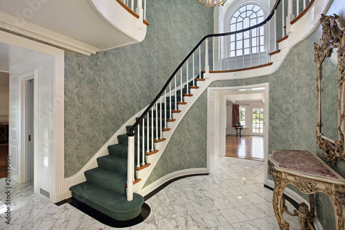 Foyer with green stairs