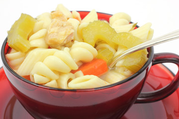 Close view of chicken rotini pasta soup