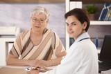 Female pensioner at doctors office poster