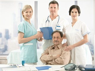 Senior patient and medical team