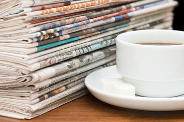 Cup from coffee and the newspaper