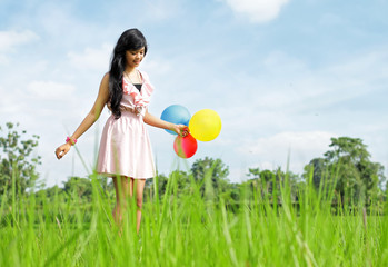 Young Girl Stepping carefully on the green grass