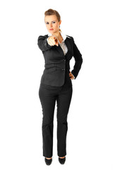 Full length portrait of business woman pointing finger at you